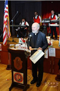 The formal part of the evening was concluded by the presentation of awards for service to the Hungarian and the American Hungarian communities. Seen here is Father Ivan Csete for his efforts in visiting rural parishioners and caring for the poor in New York.
