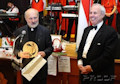 The formal part of the evening was concluded by the presentation of awards for service to the Hungarian and the American Hungarian communities. Seen here is Father Ivan Csete for his efforts in visiting rural parishioners and caring for the poor in New York with Tom Hilberth