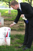 Bryan Dawson-Szilagyi places the AHF commemorative ribbon on the Gravesite of S/Sgt. Lászlo Rábel, Vietnam War hero and Congressional Medal of Honor Winner