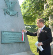 Bryan Dawson-Szilagyi places the AHF commemorative ribbon on the Gravesite of Gen. Julius Stahel, US Civil War hero and Congressional Medal of Honor Winner