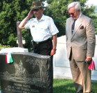 Hungarian Military Attache Col. Janos Varga salutes Gen. Alexander Asboth with AHF Assoc. President Dr. Imre L. Toth after placing the AHF commemorative ribbon on Memorial Day 2006