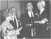 Left to Right: Ms. Anette Lantos, Rev. Imre Bertalan, Laszlo TOkes, and Congressman Tom Lantos sing a Hungarian folk song at the conclusion of the ceremony