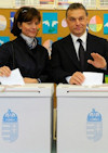 Chairman of the conservative party, the Fidesz - Hungarian Civic Alliance and prime minister candidate Viktor Orban (R) and his wife Aniko Levai (C) cast their vote at a polling station in Budapest, Hungary, 11 April. Photo exceprt from a larger image by EPA/BGNES