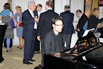 AHF and member organizations in Massachusetts raise money for Toxic Sludge victims in Hungary. Balint Varga plays at the reception.