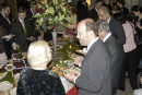 AHF's Maria Schottentstein with Slovak Ambassador Rastislav Kacer sampling the buffet at the State Department reception in honor of the 1956 Hungarian Revolution [© Bryan Dawson-Szilagyi, AHF News Service]