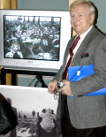 AHF's Imre Toth with his mini-documentary on the 1956 Hungarian Revolution [© Bryan Dawson-Szilagyi, AHF News Service]