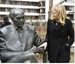 One of the daughters of the politician Katrina Lantos Swett touches the statue of her father, late US Congressman of Hungarian origin Tom Lantos during the unveiling ceremony near Lantos' former school, Berzsenyi Daniel Secondary School, in Tom Lantos Walk in Budapest, Hungary, Thursday, Feb. 1, 2018. (Noemi Bruzak/MTI via AP) (Associated Press)