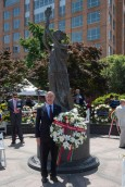 AHF International Relations Committee member Paul Kamenar with AHF's wreath at the Victims of Communism Memorial in Washington, DC