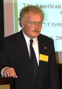 Rev. Imre Bertalan. Jr. delivering the invocation at a 2005 Board meeting of the American Hungarian Federation.