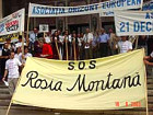 Demonstrators against Rumania's planned destruction of churches, cemeteries, homes and displacing an entire village to make room for one-mile-wide, open-pit cyanide mine.