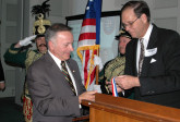 Frank Koszorus presents Cong. Tom Tancredo with AHF's Col. Commandant Michael Kovats Medal of Freedom